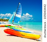 colorful kayaks and sailing... | Shutterstock . vector #105043442