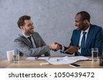 multicultural business partners ... | Shutterstock . vector #1050439472