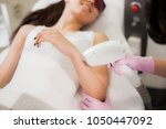 a beautiful girl lies in the... | Shutterstock . vector #1050447092