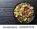 healthy hearty salad of tuna ... | Shutterstock . vector #1050497078