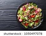 healthy hearty salad of tuna ... | Shutterstock . vector #1050497078