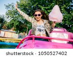 smiling attractive girl in... | Shutterstock . vector #1050527402