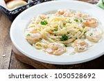 creamy fettuccine alfredo with... | Shutterstock . vector #1050528692