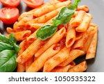 tasty pasta with tomato sauce...   Shutterstock . vector #1050535322