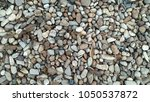 dirty rocks and leaves... | Shutterstock . vector #1050537872
