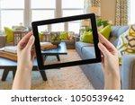 female hands holding computer... | Shutterstock . vector #1050539642