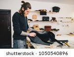 working process of the leather... | Shutterstock . vector #1050540896
