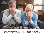 sick couple are trying to... | Shutterstock . vector #1050545252