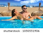 tourist couple bath in infinity ... | Shutterstock . vector #1050551906