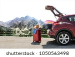 summer trip and car on road... | Shutterstock . vector #1050563498