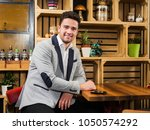 young businessman sitting in a... | Shutterstock . vector #1050574292