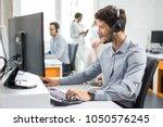 smiling handsome customer... | Shutterstock . vector #1050576245