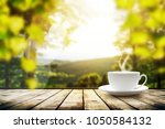 cup with tea on table over... | Shutterstock . vector #1050584132