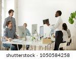 new african employee unpacking...   Shutterstock . vector #1050584258