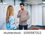 pensive student with netbook in ... | Shutterstock . vector #1050587312
