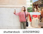 beautiful young consumer woman... | Shutterstock . vector #1050589082