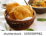 homemade indian potato poori or ... | Shutterstock . vector #1050589982
