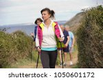 senior people nordic walking by ... | Shutterstock . vector #1050601172
