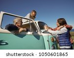 Senior people on a road trip with camper van reading map - stock photo