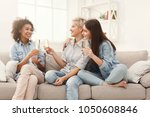 three friends toasting with... | Shutterstock . vector #1050608846