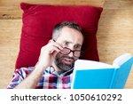 portrait of handsome bearded... | Shutterstock . vector #1050610292
