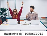 happy two students rejoicing to ... | Shutterstock . vector #1050611012