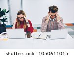 overworked and tired two... | Shutterstock . vector #1050611015