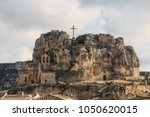 Small photo of Italy, Southern Italy, Region of Basilicata, Province of Matera, Matera. The town lies in a small canyon carved out by the Gravina. Overview of town. The cave church Madonna de Idris.