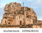 Small photo of Italy, Southern Italy, Region of Basilicata, Province of Matera, Matera. The town lies in a small canyon carved out by the Gravina. Overview of town. The cave church Madonna de Idris