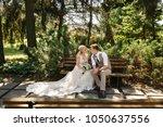 rustic wedding. bride and groom ...   Shutterstock . vector #1050637556