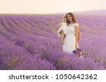 happy mother with pretty... | Shutterstock . vector #1050642362