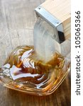 Small photo of pushing out tokoroten(gelidium jelly) by tentsuki(special inplement), japanese summer food