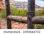 barbed wire rusted wooden fence ... | Shutterstock . vector #1050666722