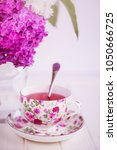 lilac in vase and tea cup | Shutterstock . vector #1050666725