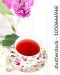 lilac in vase and tea cup | Shutterstock . vector #1050666968