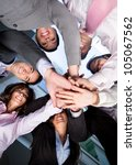 Group of business people with hands together - teamwork concepts - stock photo