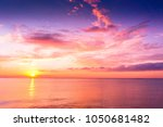 sunset over water glowing... | Shutterstock . vector #1050681482