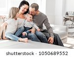 young family at home having fun ... | Shutterstock . vector #1050689552