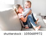 little sister with her baby... | Shutterstock . vector #1050689972