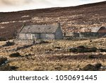 abandoned croft of rychorrach... | Shutterstock . vector #1050691445