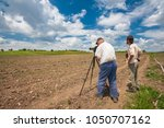 two bird watchers  tweechers in ... | Shutterstock . vector #1050707162