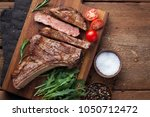 grilled cowboy beef steak ... | Shutterstock . vector #1050712472