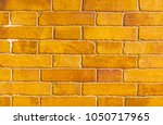 old brick placed in the wall ... | Shutterstock . vector #1050717965