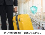 travel insurance  shield... | Shutterstock . vector #1050733412