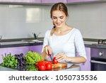 young happy woman is preparing... | Shutterstock . vector #1050735536