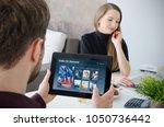 man using digital tablet for... | Shutterstock . vector #1050736442