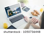woman using laptop for watching ... | Shutterstock . vector #1050736448