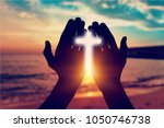 human hands open palm up worship | Shutterstock . vector #1050746738