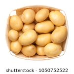 raw potatoes in basket isolated ... | Shutterstock . vector #1050752522