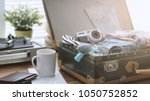 traveler packing his luggage... | Shutterstock . vector #1050752852
